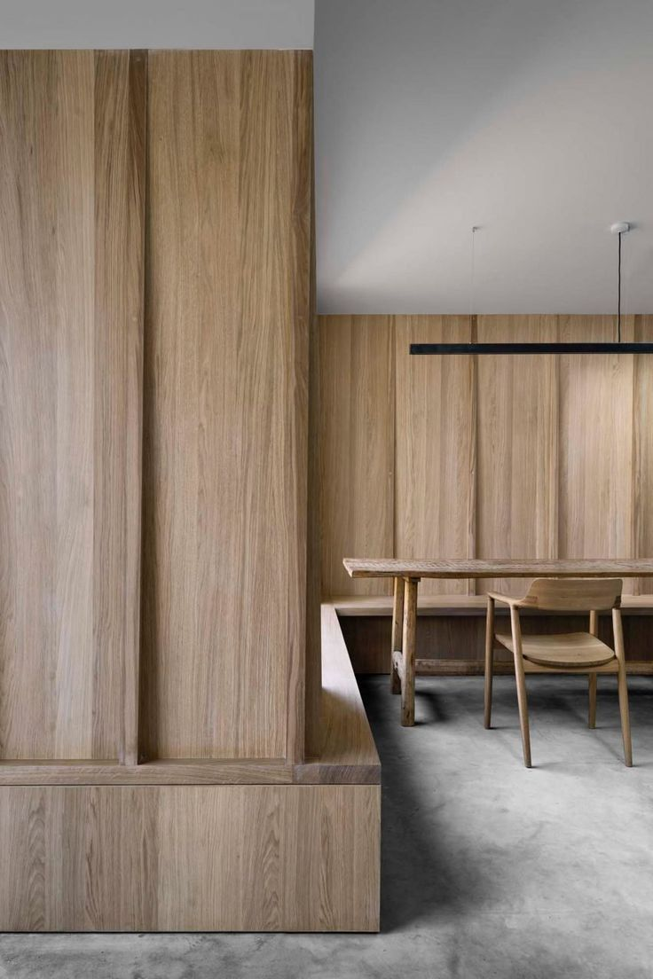 The dark, patinated concrete contrasts with extensive wall panelling and joinery in oak that introduces a softer, natural tone and finish to the interior.