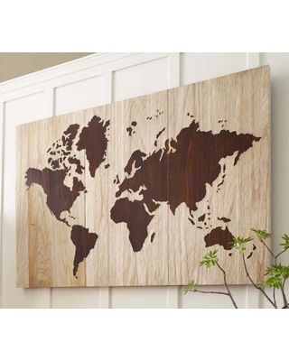 take inexpensive wood or ???, trace a world map, and then paint.......OR....do they sell the world map in adhesive?