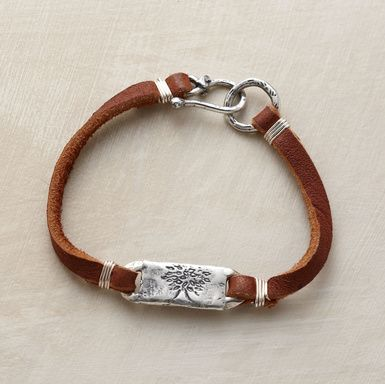 "Like the wise oak tree on this bracelet's sterling charm, ""grow strong"" is etched on the back of the charm. Deer suede and sterling silver with hook and eye clasp. Handmade in the USA by Jes MaHarry. 7-1/4""L."