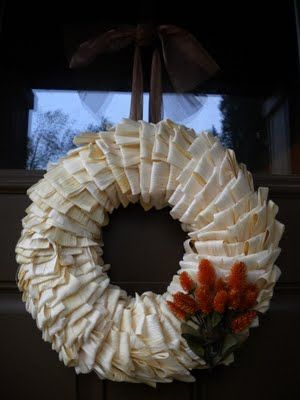 Corn Husk Wreath  -Straw wreath from Jo-Ann Fabrics  -T-pins (approximately 200)  -One 8oz package of dried corn husks (you can get them in the grocery store in the Mexican food section)  -Ribbon or something to hang your wreath with  -Fall inspired faux flower  -Hot glue gun with glue  -Total Cost: About $15.00