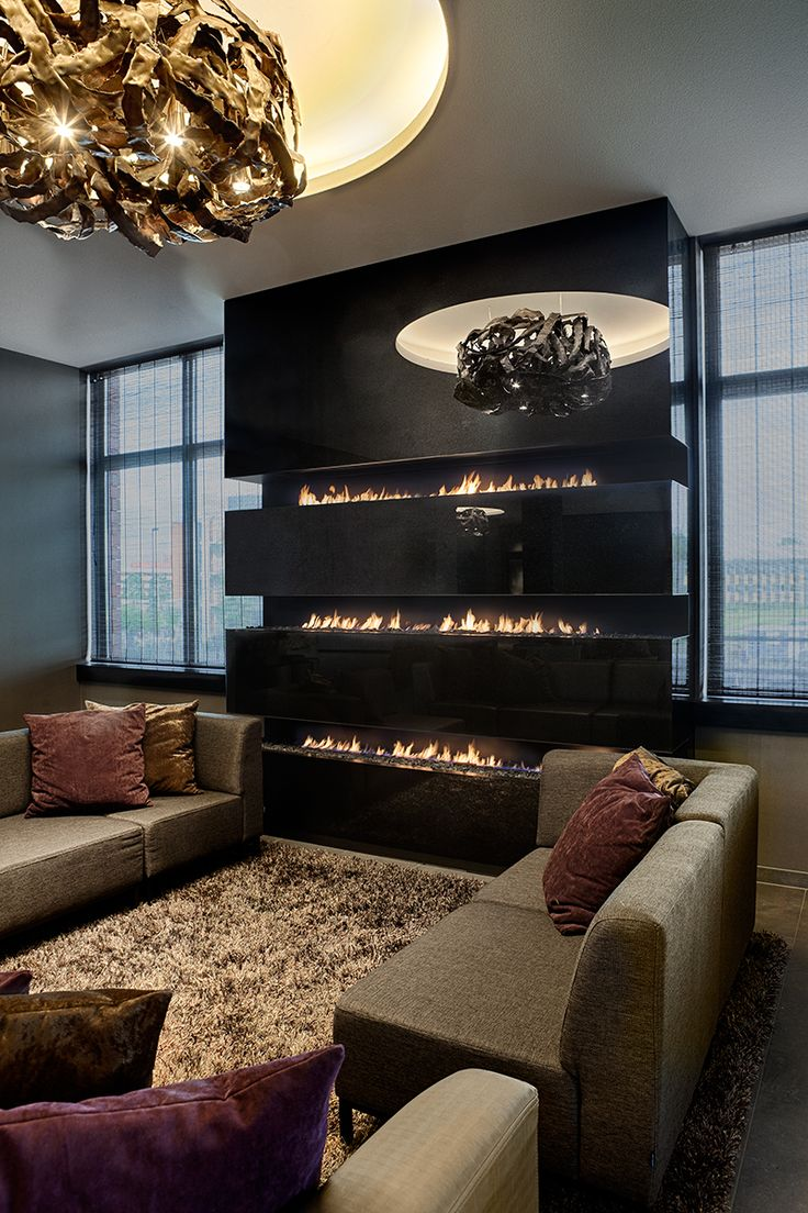 Talk about a 'wall of fire'! Another design that could be adapted for the Dimplex Optimyst open-hearth cassettes. Inbouw Gashaard. Drievoudige lijnbrander Boley