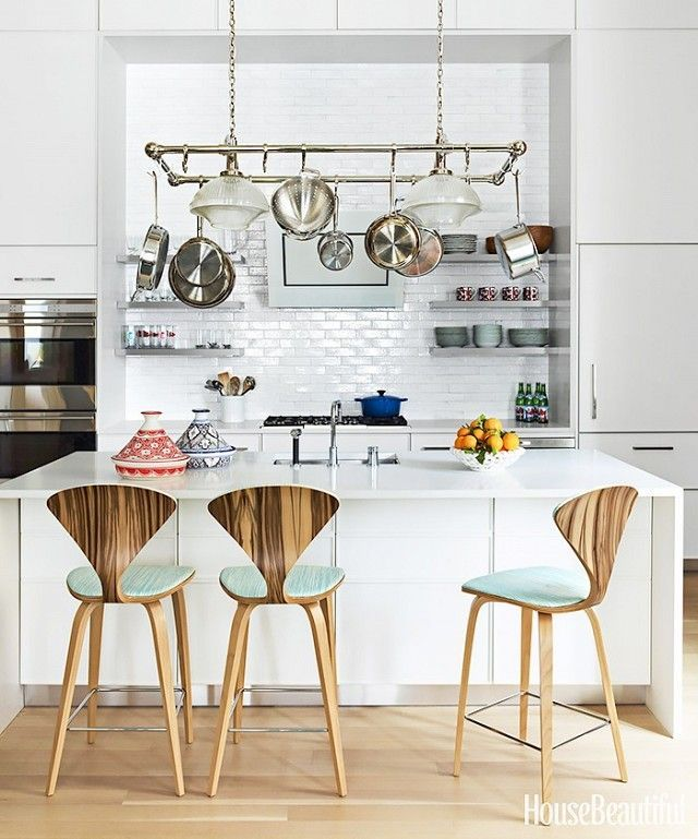 Modern all-white kitchen with reupholstered mint green bar stools