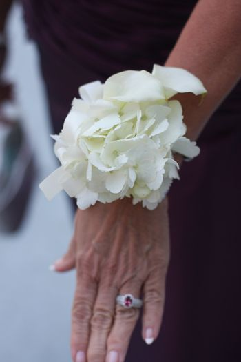 This white hydrangea corsage looks like a piece of jewelry rather than a corsage.  Added bonus, compliments anything the moms, grandmothers & readers will wear.