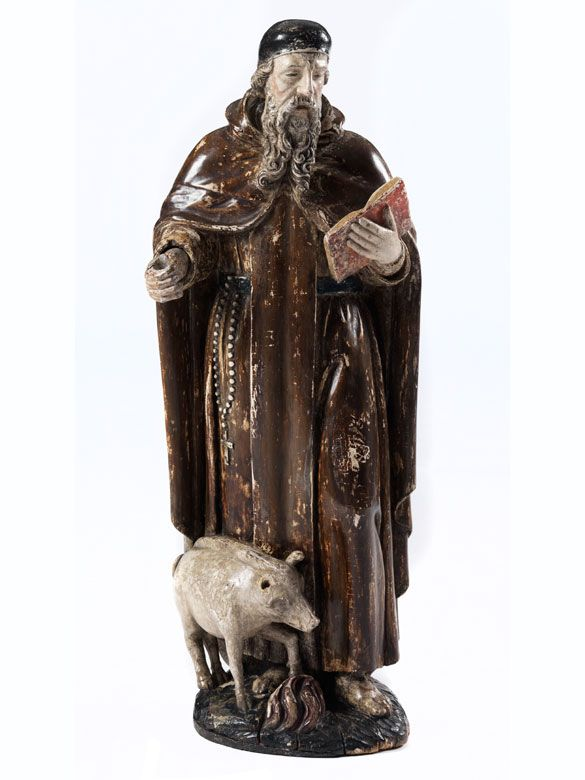 Heiliger Antonius Höhe: 83,5 cm. Südliche Niederlande, 16. Jahrhundert. Holz, geschnitzt und gefasst. Vollrund geschnitzt, nicht gehöhlt, wandseitig abgeflacht. Der Heilige...