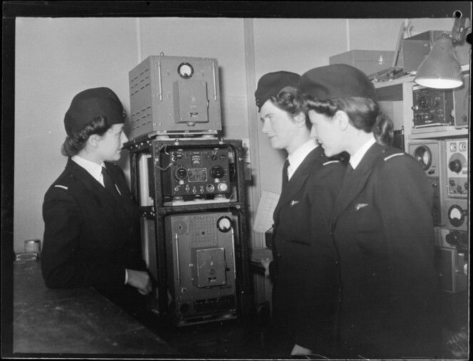 TEAL Tasman Empire Airways stewardesses, examining radio. Date: Aug 1946. Photograph taken by Whites Aviation.