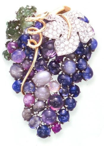 DORIS DUKE GRAPE CLUSTER BROOCH~ Magnificent gems in tones if blue, rose and violet. Sapphires, star sapphires, moonstone, amethyst, tourmaline, chalcedony, accented with diamonds and emeralds,and 18k gold.