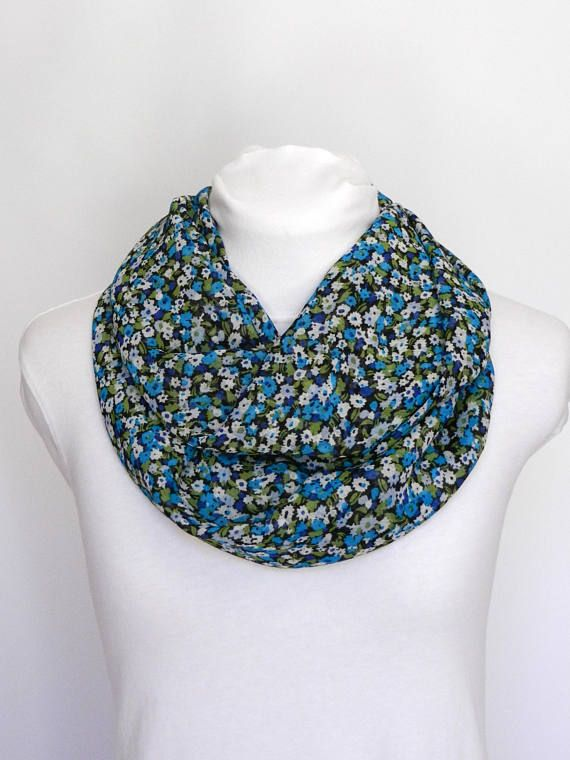 This floral infinity scarf is the perfect accessory to wear throughout the day to accent your outfit. Its lightweight fabric is soft and comfortable to wear. You can wrap it around your neck twice or wear it in a single loop.