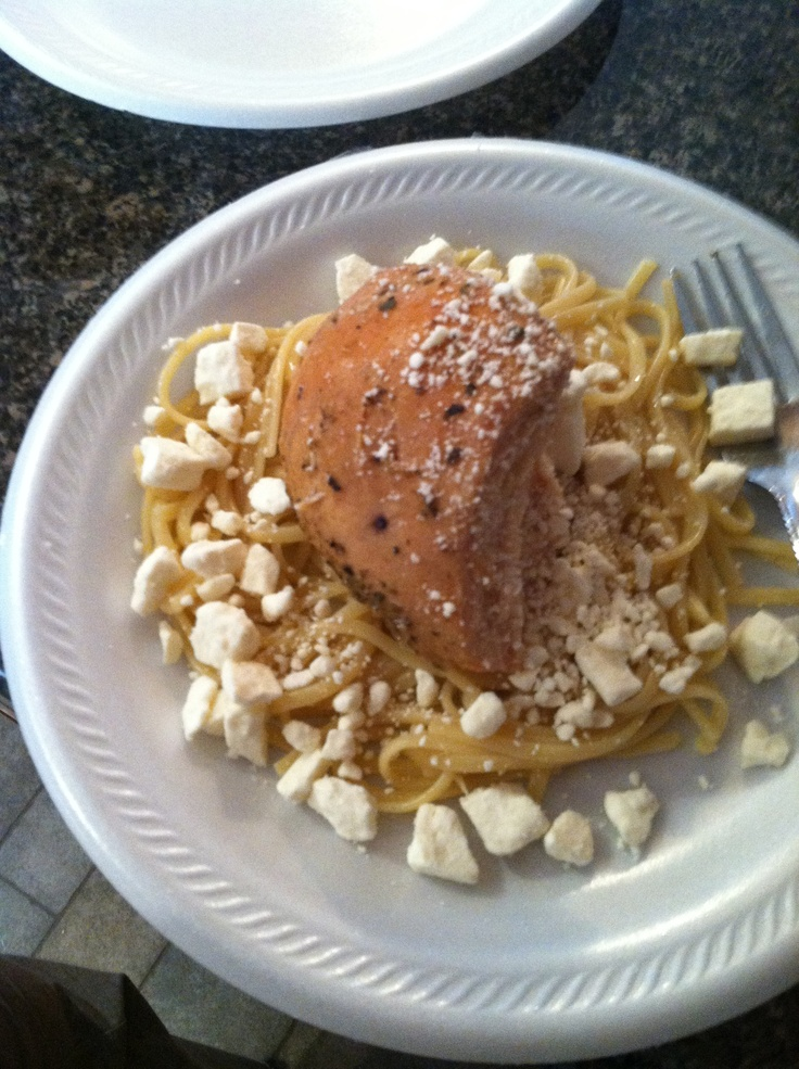 Boneless chicken breast in crockpot for 10 hours on low. I added one bottle of gazebo room dressing and put all into crockpot with liner. Topped it off with past and feta cheese! Chicken was very moist and delicious.