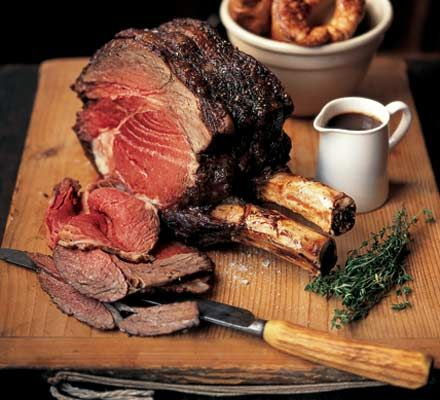 Roast Rib of Beef,  The only way to cook a rib of beef. Roasting on a bed of parsnips, carrots, onions, garlic and thyme...And the delicious gravy needs just the one bottle of red!
