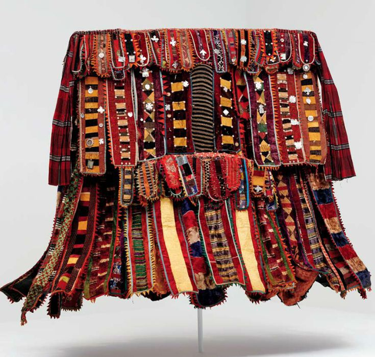Africa | Egungun costume from the Yoruba people of Oyo or Ogbomoso area, Nigeria | ca. 1920 - 1950 | Cotton, silk and wool fabric, metal, leather, mirrors, cotton and wood