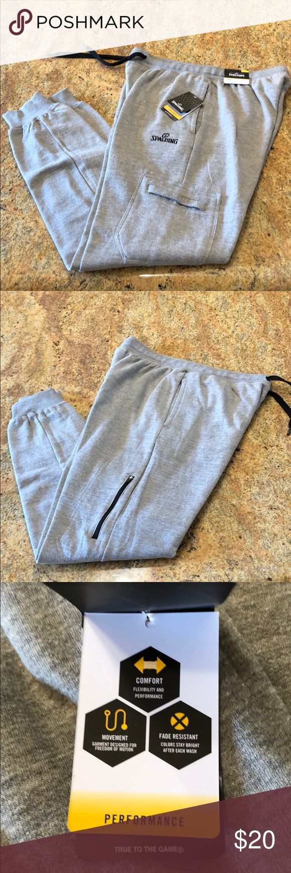 "NWT Spalding Joggers Men's heather grey joggers from Spalding. Cotton/Poly blend. Side pockets. Each leg also as a pocket- zippered pocket on side of right leg and slide pocket on side of left leg. Size large. Inseam 32.5"". New with tags. spalding Pants Sweatpants & Joggers"