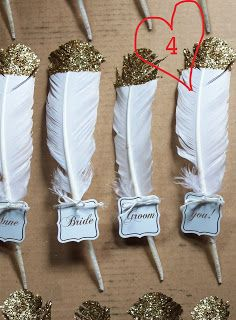 Wedding seating idea: DIY Glittered Feather Place Cards #greatgatsby