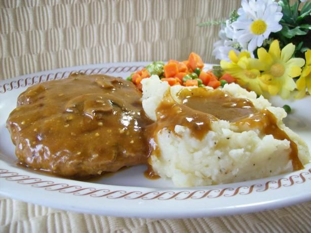 Smothered Hamburger Steak from Food.com: Made this with 2 lbs hamb meat mixed with 1 packet of onion soup mix. I used 2 bullion cubes and 1 can of water instead of gravy mix. Was so good!  An easy hamburger steak recipe, smothered in brown gravy. Good comfort food!