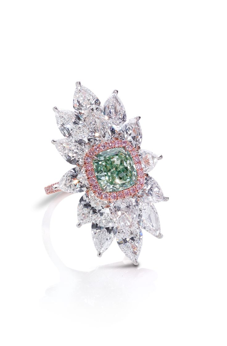 An Exceptional Cushionshaped Fancy Intense Green Diamond Highlighted By  Pink Pave Diamonds And Mounted Colored Diamondspink Diamondsjewelry