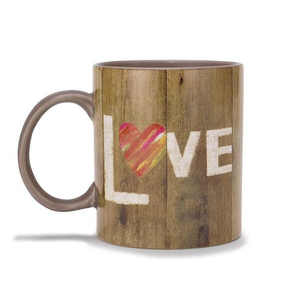 """Show your love with this adorable mug! Rustic wooden plank look with """"LOVE"""" written on it. The """"O"""" is a red heart.FEATURES• Holds up to 14 oz• Approx. 3 1/3"""" diam. X 3 3/4"""" H• MicrowaveableMATERIALS• CeramicCARE• Dishwasher safeIntroducing Craft Collective:  A handcrafted lifestyle brand created by unique artists with collections designed EXCLUSIVELY for Avon. Shop the Craft Collective Rustic Love Mug, Life is Short Kiss Frame, and the Love Serving Tray by ... AvonRep shirlean walker"""