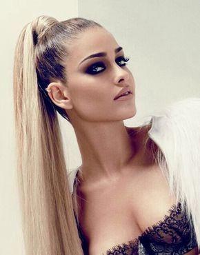 High, sleek ponytail for long hair. Super high straight ponytail, hair wrapped around bobble. Model - Anna Beatriz Barros.