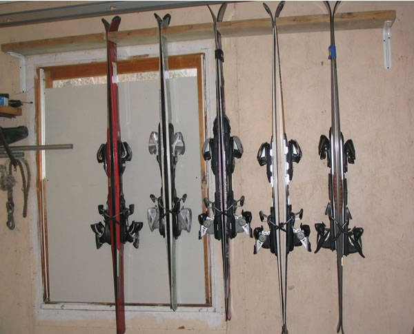 A DIY ski rack is the perfect place to put your skis for the summer.  This one frees up some storage space nicely.  #Organizing.