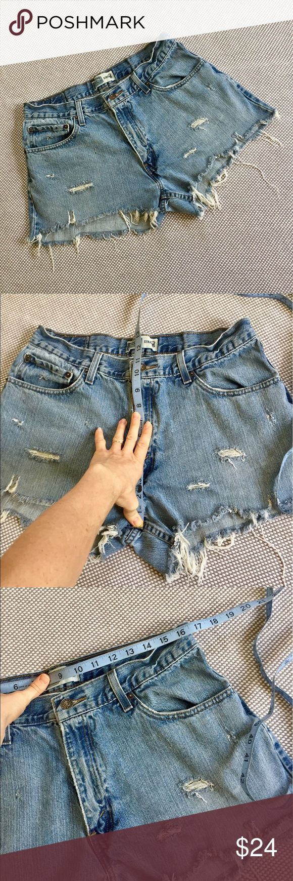 "Vintage high waist Levi's shorts distressed Light blue distressed Levi's shorts with beautiful fraying! Rise of 11"" flatters your tummy! Waist flat of 16.5"" and hips flat of 23.5"" which would best fit a 33 or 34. Compare to vintage Levi's retailing at Aritzia, Urban Outfitters, Brandy Melville, Anthropologie, and ASOS! Offers welcome ASOS Curve Shorts Jean Shorts"