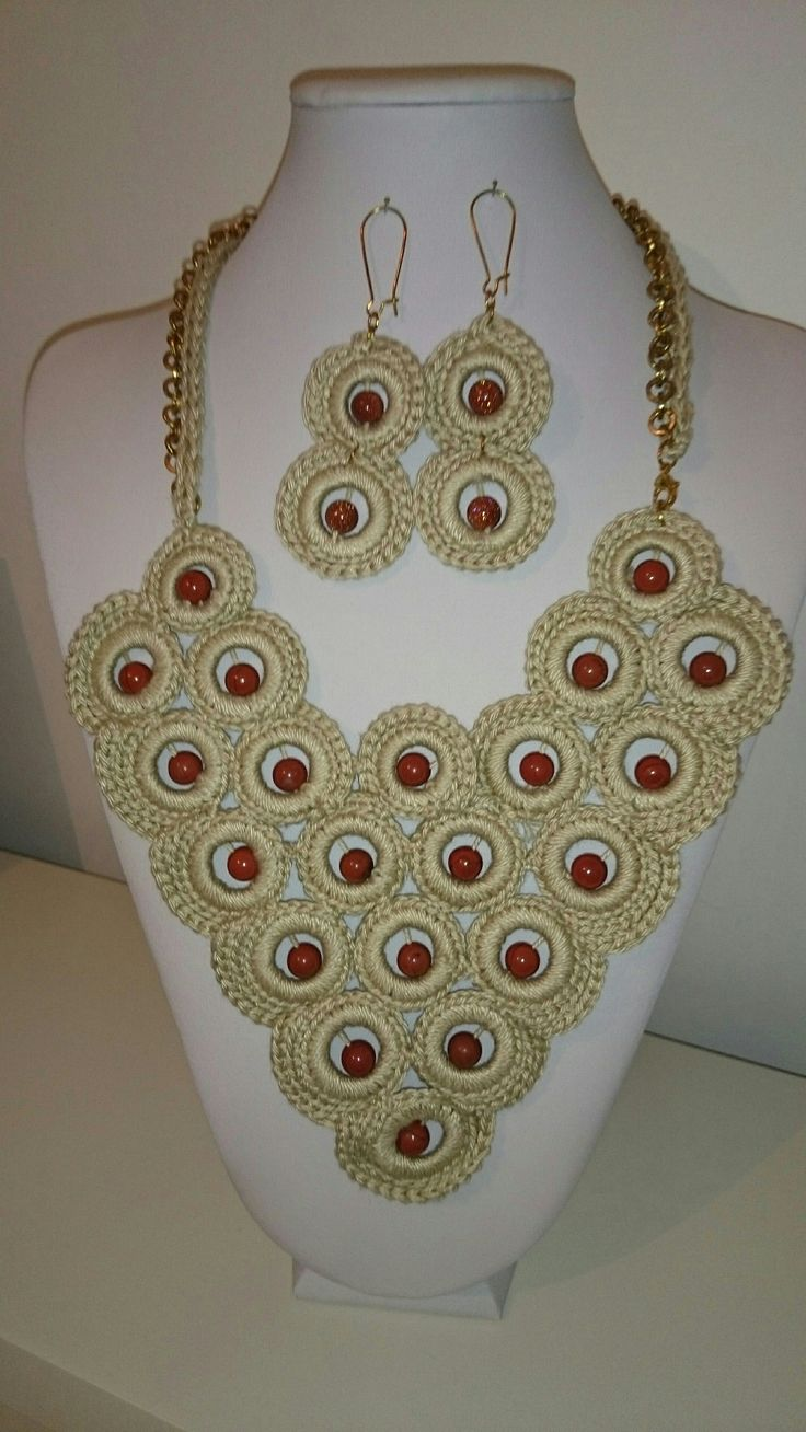 Handmade crochet necklace and matching earrings with semiprecious beads.