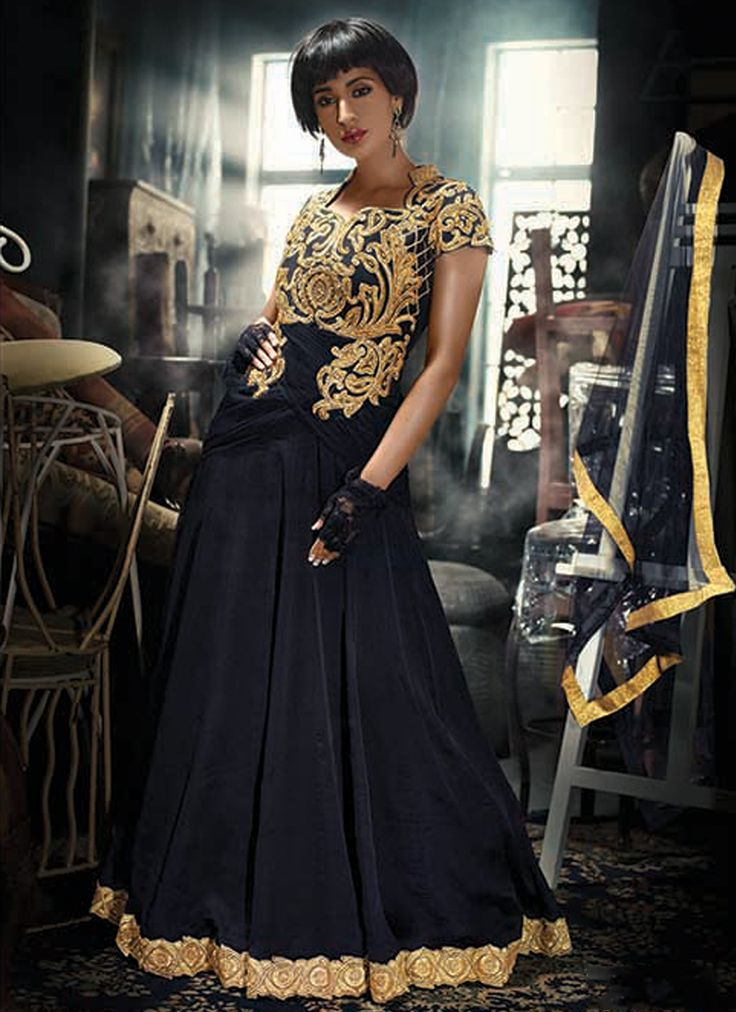 Featuring black and golden embroidered indo western gown intricately designed with heavy paisley embroidery. It is paired with matching net duppata.This gown can be stitched upto size 44. For stitching enquiries, please email us at customercare@hunardesigns.com   …