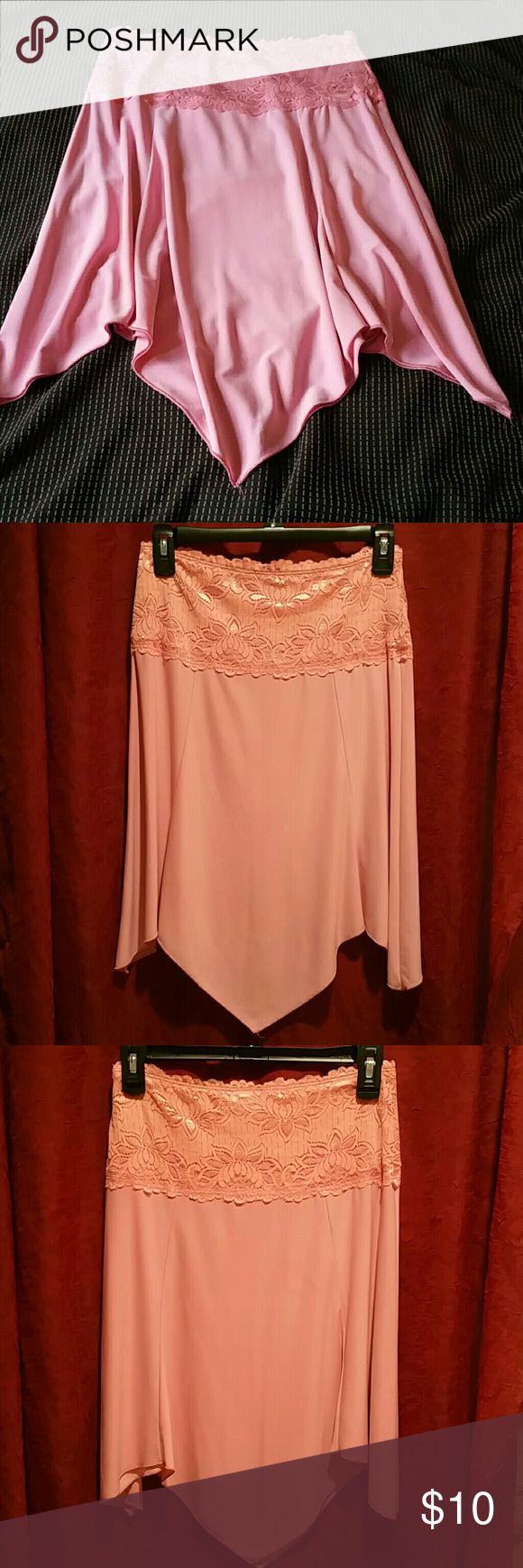 Le Chateau slinky, flowy knee-length skirt Vintage pink slinky, stretchy, flowy skirt. Waist band in lace, stretchy pull on style. Purchased from Le Chateau, at that time, a small Canadian boutique. Wore to a few salsa lessons. I'd imagine not a lot of these gems are still floating around. Skirts