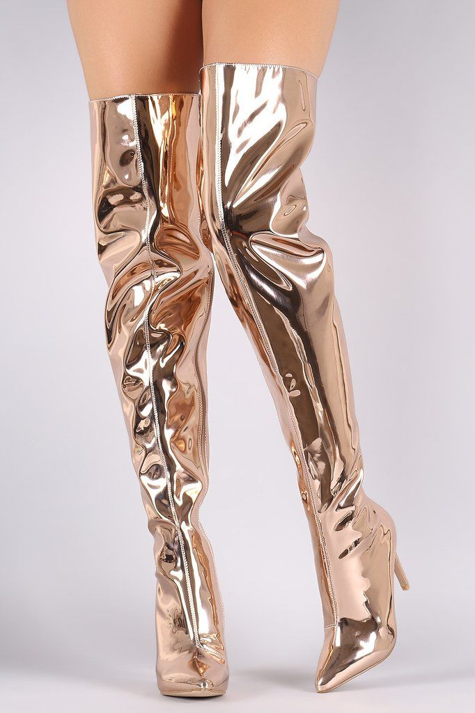 These striking over the knee boots feature a mirror shine design, pointy toe, and wrapped stiletto heel. Finished with a cushioned insole, smooth lining, and full-length side zipper closure. Material: