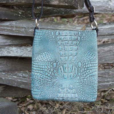 Antique turquoise colored concealed carry handbag in embossed crocodile leather.