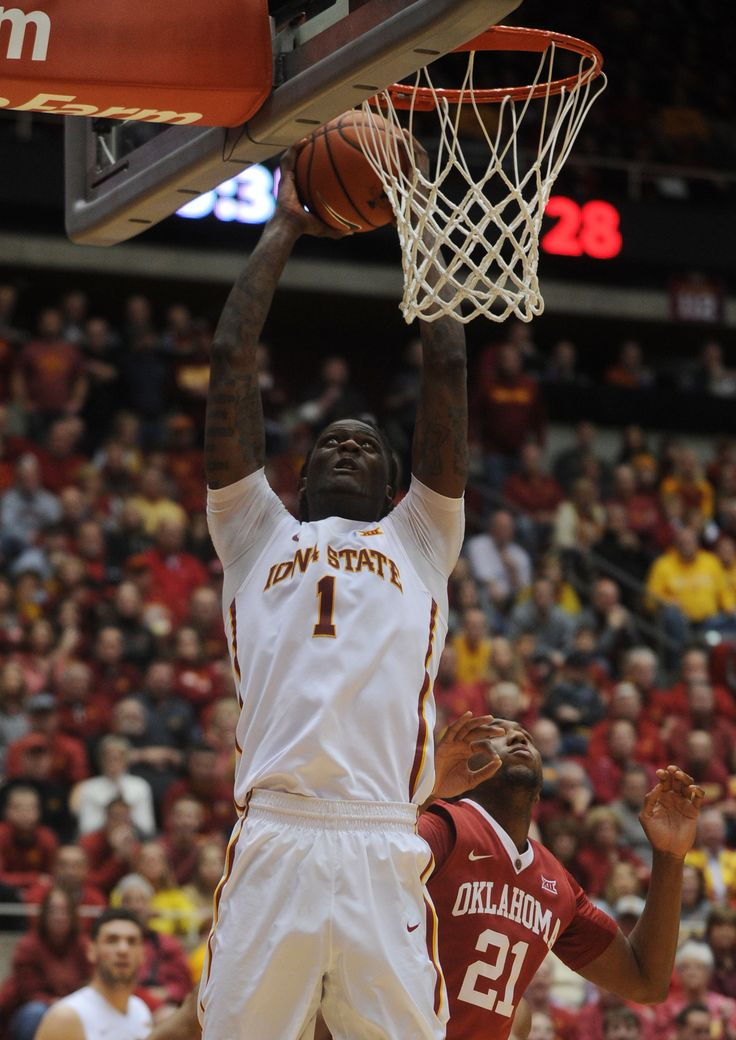 Iowa State's Jameel McKay goes for dunk around Oklahoma's Dante Buford during a win over the top ranked Sooners at Hilton Coliseum on Monday. Photo by Nirmalendu Majumdar/Ames Tribune   http://amestrib.com/sports/men-s-basketball-no-19-isu-treats-win-over-no-1-oklahoma-routine