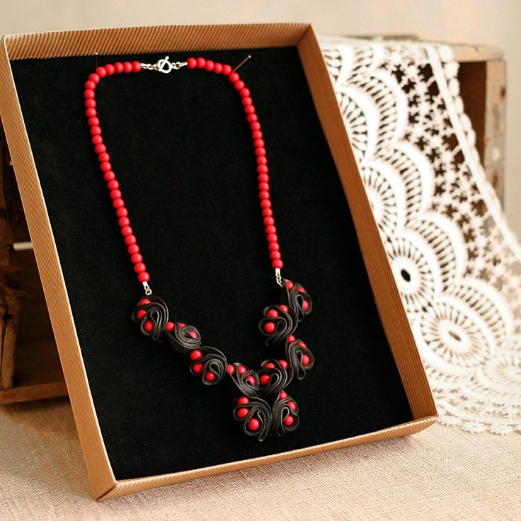 Dragon eye necklace, red via ACCE, 65 €. Click on the image to see more!