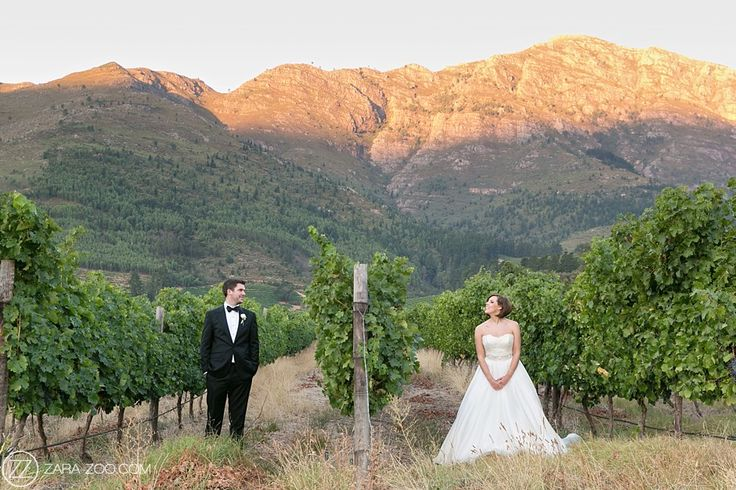 Wedding couple photos in the vineyards at La Residence Franschhoek