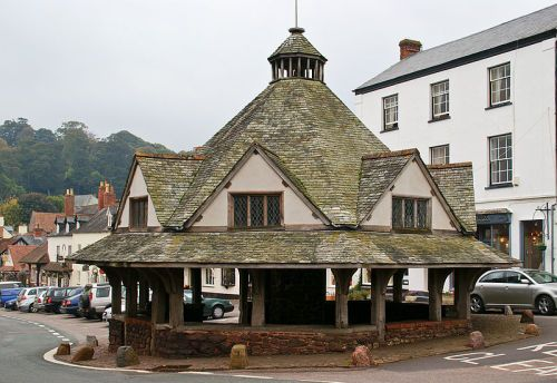 The Yarn Market in Dunster, Somerset. Since 1222, the town of Dunster was a busy centre for the production and trade of wool and cloth. In 1590, the Market was constructed to shelter traders and their wares from the rain. One of the roof beams has a...