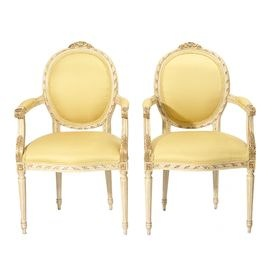 Set of two vintage Renaissance-style gilt wood cameo chairs with yellow upholstery.   Product: Set of 2 chairsConstruction Material: Wood and fabricColor: Yellow and goldFeatures: Circa 1960sDimensions: 40 H x 24 W x 22 D eachNote: Due to the vintage nature of this product, some wear and tear is to be expected. Products may show signs of brand marks, scrapes or other blemishes.