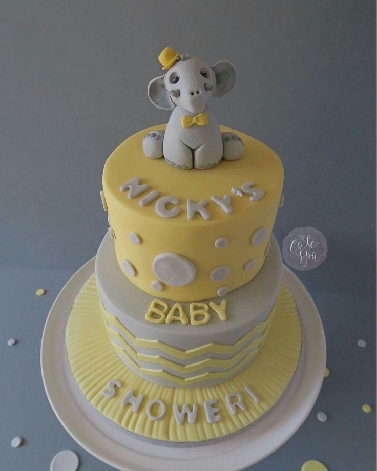 Lemon and grey baby shower cake with spots and chevrons and cute elephant topper