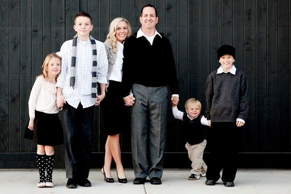 family.  black and white outfits.