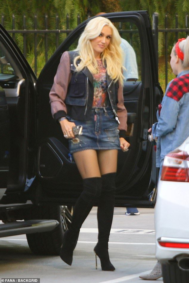 Gwen Stefani Struggles With Her Denim Mini Skirt As She