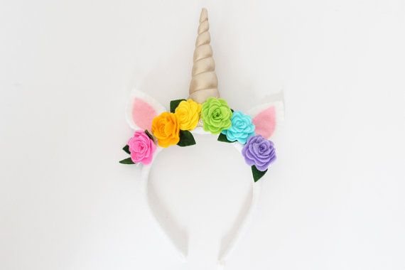 Rainbow rose unicorn horn headband with golden spiral horn. Unicorns and rainbows are closely associated, and Ive brought the two together in