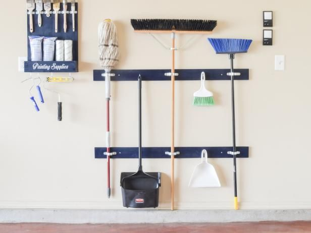The experts at HGTV.com share easy instructions on how to build a cleaning tool holder for your garage using scrap wood and pipe straps.