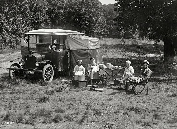 "Washington, D.C., or vicinity circa 1920. ""Dr. A.A. Foster and family of Dallas, Texas, in auto tourist camp."" A novelty that would evolve into tourist cabins of the 1920s and '30s, the motor courts of the '40s and '50s and culminate in the motor hotel, or ""motel."" Harris & Ewing glass negative."