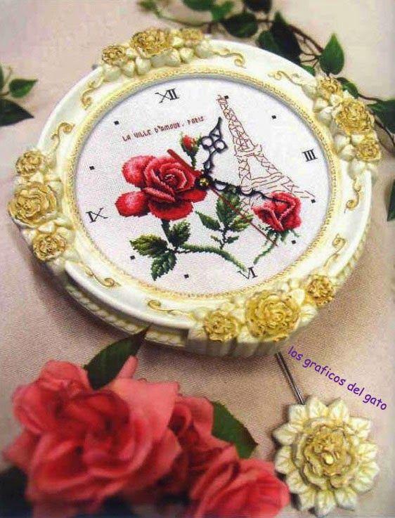Bonito gráfico de un reloj con la Torre Eiffel y rosas...
