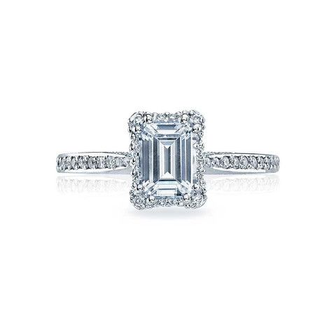 18Kwg Melee=.25 Gvs Br Dantela Setting; A Classic Look With Modern Flair, A Crown Of Diamonds Surrounds An Emerald-Cut Center Stone, Adding Depth And Dimension.
