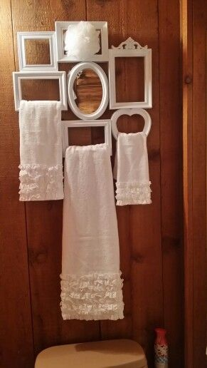 Love the way these vintage frames are used as towel holders!