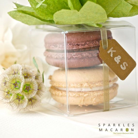You cannot get a more delectable, chic & lovely tidbit to spoil guests with, than a French Macaroon. Use them on a gorgeous color-coordinated dessert or candy bar, or ask a true baker to make & package into delicate, fanciful favors. I'd add another fun treat: an Eiffel Tower bottle stop & mini bottle of champagne (or 2!) tied together with big burlap bows that have 2 bright paper straws tucked in, for guests to  share before ending a magical evening in bed.    Pom Pom Macaron Favor - Set of…