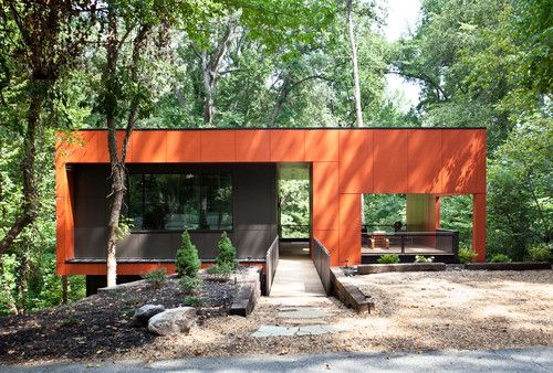 The aptly named Overlook Residence, outside Atlanta, is a modern box with a burnt-orange exterior wrapping around a gray box. An outdoor room on the right is the focus of the design, providing an area in which to bask in the view.