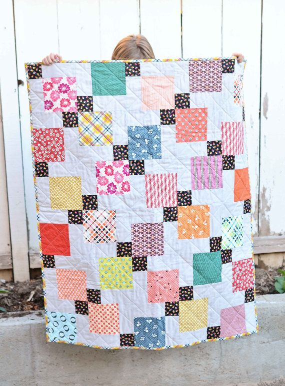 Disappearing 9-Patch quilt. This is a baby quilt made using a variety of Denyse Schmidt prints and Kona cotton.