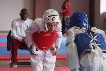 A taekwondo family describe the benefits of taekwondo for children. Taekwondo kids gain physical fitness, mental strength, self confidence and self esteem.