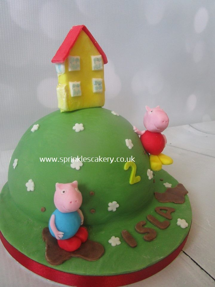 "This Peppa Pig cake was made using half of 6"" sphere cake tin and then decorated in fondant. All decoration was handmade and 100% edible."