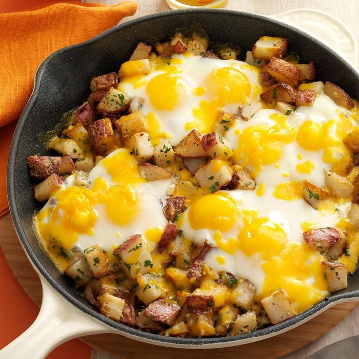 Baked Cheddar Eggs & Potatoes Recipe -I love breakfast for dinner, especially this combo of eggs with potatoes and cheese started in a skillet on the stovetop and then popped into the oven to bake. —Nadine Merheb, Tucson, Arizona