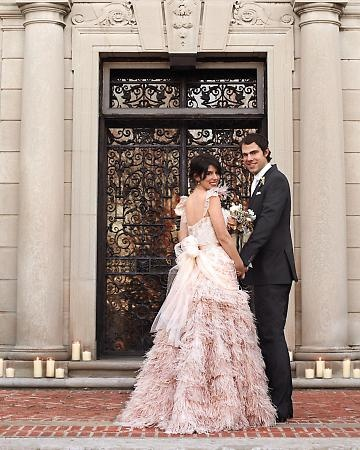 Venue: You don't have to travel to Europe to find a grand setting: This designer duo hosted a sophisticated soiree in a historic home just a few miles north of New York City.  Bride Annie Sullivan, in a silk-tulle, French lace, and ostrich-feather dress of her own design, and groom Oliver Cobb, in a Ralph Lauren Black Label tuxedo, pose at the entrance of Alder Manor in Yonkers, New York.