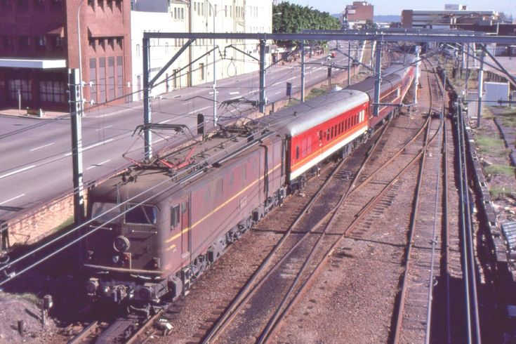 SRA NSW electric 4631 hauls the Down Newcastle Express from Sydney into Newcastle station, NSW, June 9 1985. The Express (or Flyer) was the premium train connecting Sydney and Newcastle until it was discontinued in favour of electric multiple unit trains.
