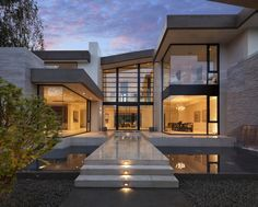 Curb view of the magnificent steel and glass modern mansion in Los Angeles by McClean Designs.  Designed by McClean Design